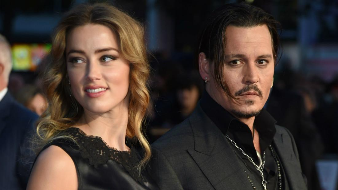 Amber Heard wore a lacy sleeveless gown next to Johnny Depp, who sported a tie-less black suit.