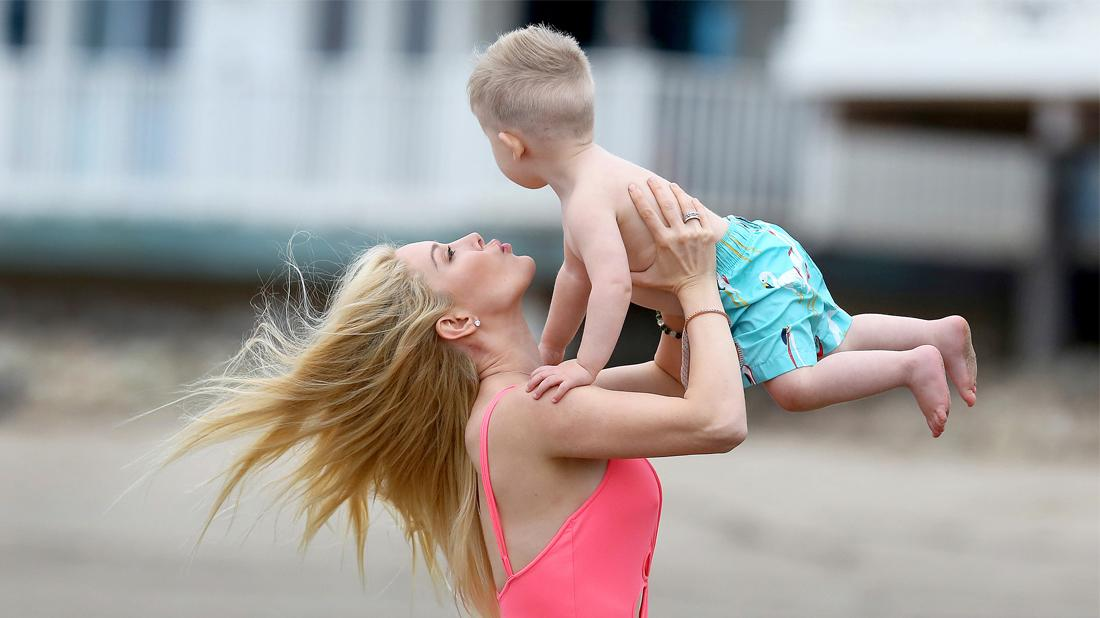 Heidi Montag Enjoys Beach Day in Sexy Pink One Piece with Spencer and Baby Gunner