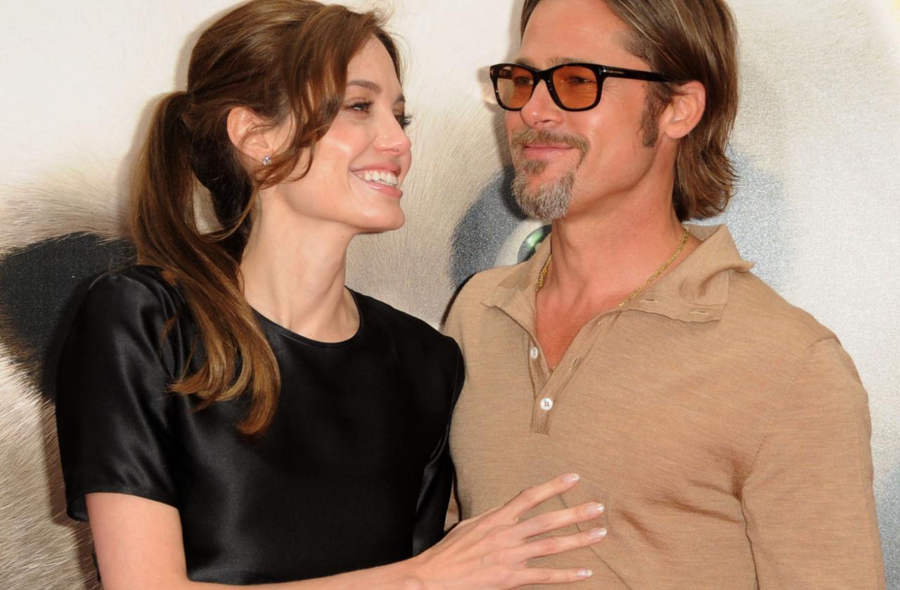 Angelina Jolie and Brad Pitt pose for the camera