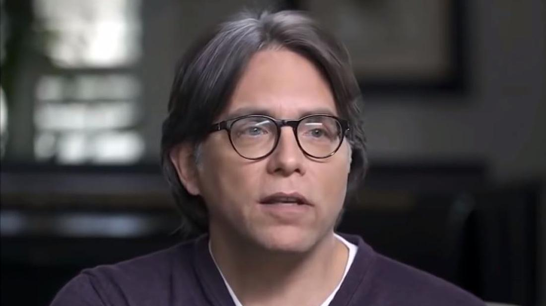 Keith Raniere of NXIVM in Glasses and Purple Shirt