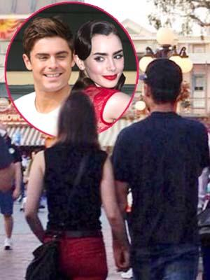zac-efron-lily-collins-disneyland-california-holding-hands