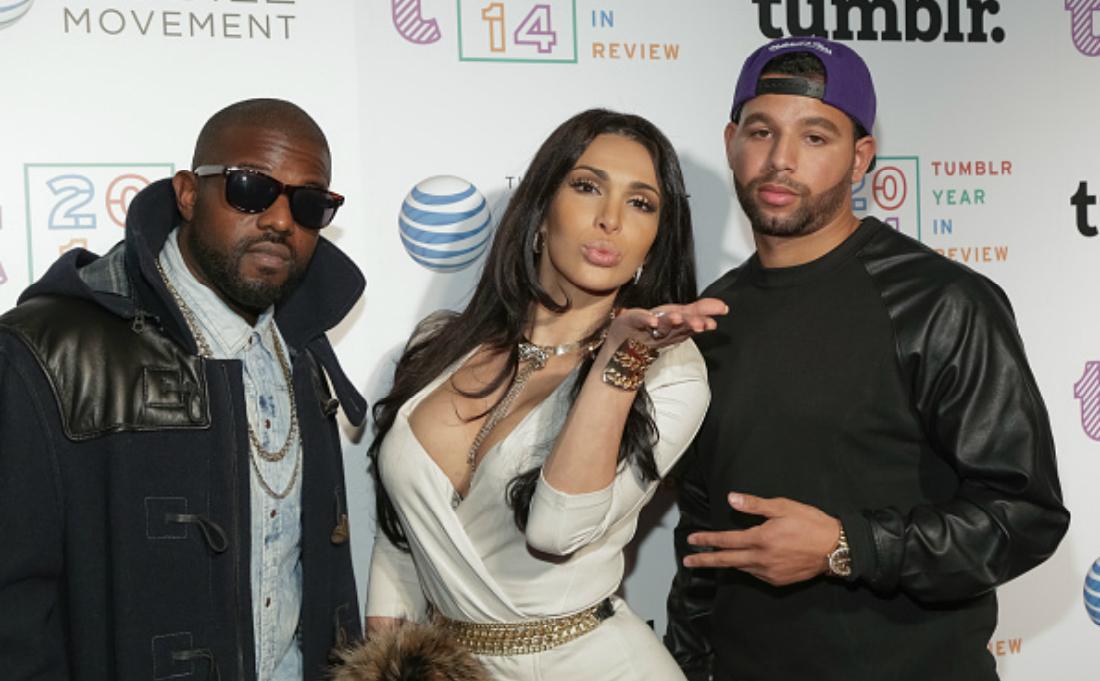 Kanye West, Kim Kardashian and Drake pose on the red carpet.