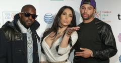 Kanye West, Kim Kardashian and Drake pose on the red carpet.
