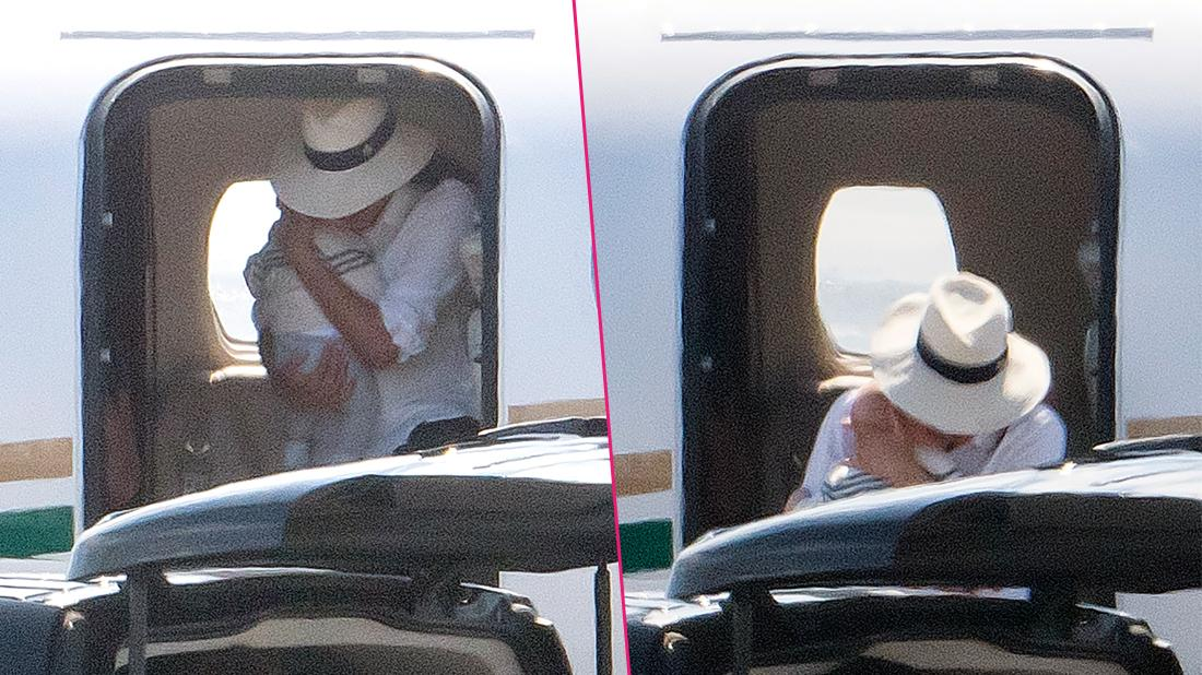 Meghan Markle cradles baby son Archie in both arms as she leaves the luxury private jet