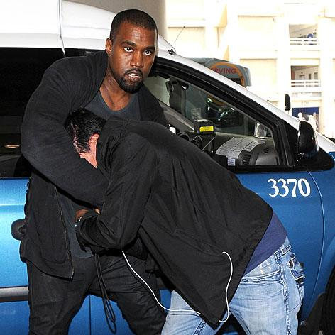 //kanye west pap scuffle