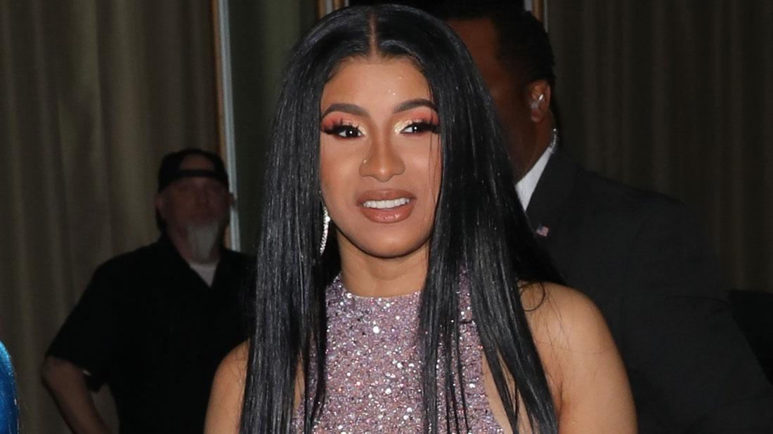 Cardi B wears a sparking pink dress at an event with Offset.