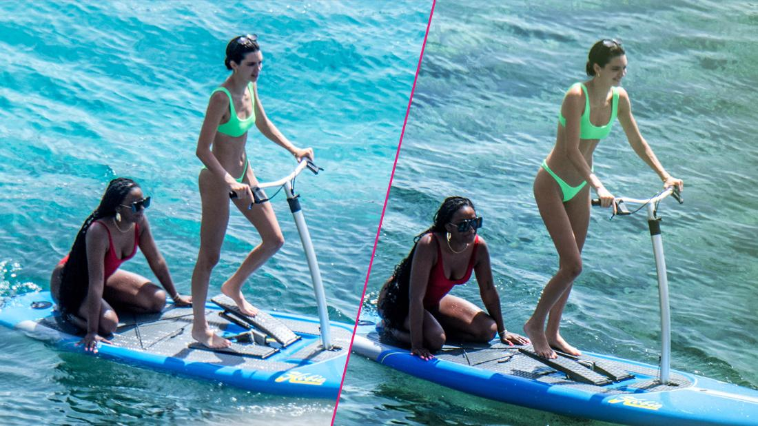 Kendall Jenner wears a neon-green bikini while having fun with friends paddle boarding in Mykonos.