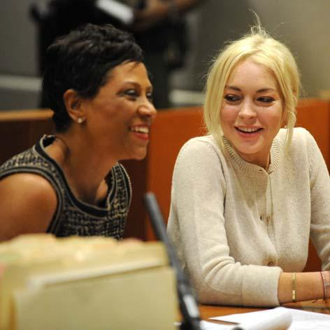 //lindsay lohan shawn holley square getty