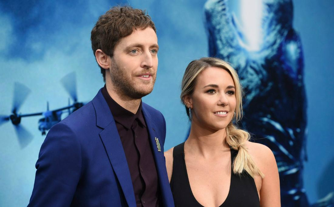 Thomas Middleditch and Mollie Gates stand on the red carpet. He's ina blue jacket and black top; she's in a black dress.