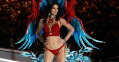 Kendall Jenner wears red lingerie and colorful wings at the 2016 Victoria's Secret Fashion Show.
