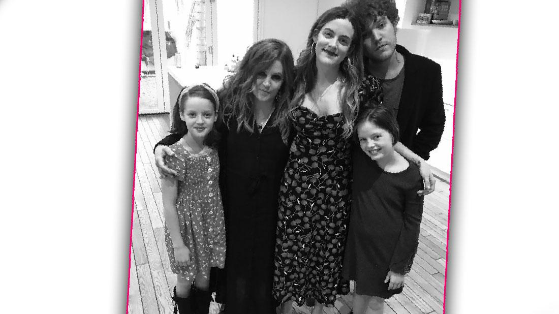 Lisa Marie Presley stands with her four kids.