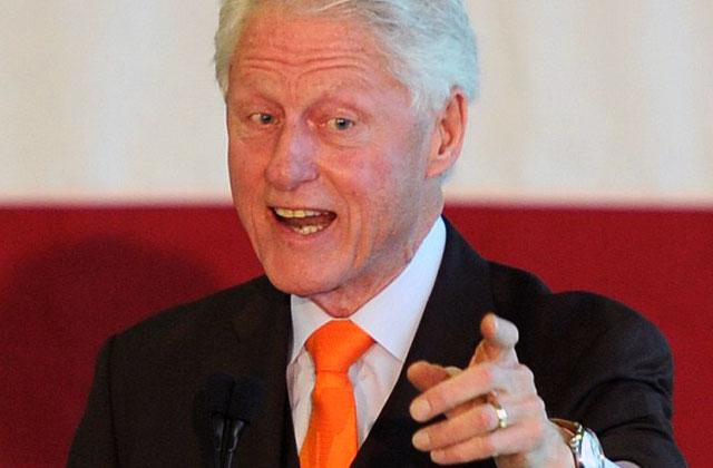 Bill Clinton Sexual Assault Allegations Protester Calls President Rapist