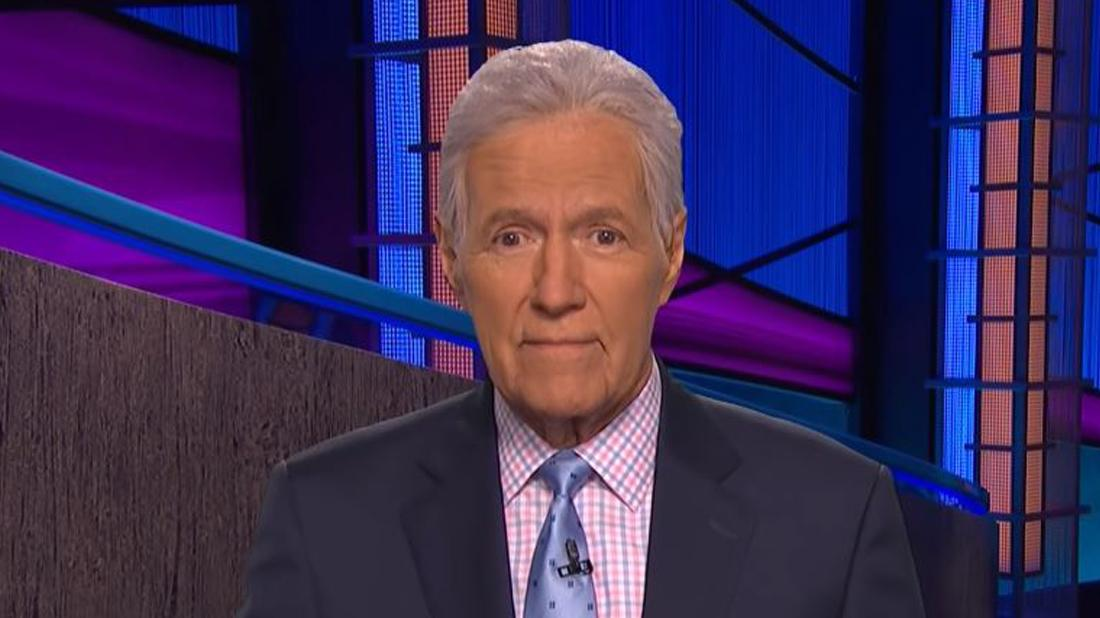 Alex Trebek Smiles in a Suit on Jeopardy Set