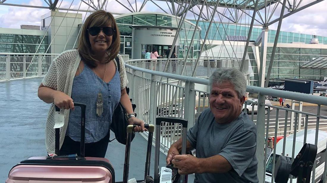 Matt Roloff and Caryn Chandler pose for a photo at their nearby airport.