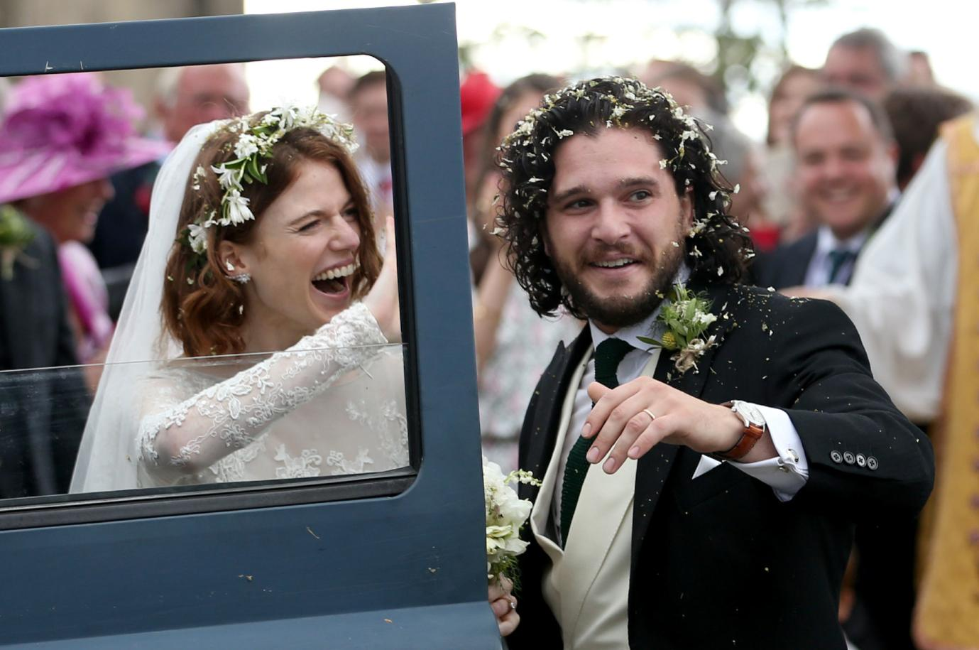 Kit Harington and Rose Leslie smile on their wedding day with their Land Rover Defender getaway car