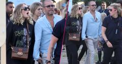 Adele is seen surrounded by bodyguards while holding hands with a male friend in Hyde Park, London, where Celine Dion was headlining.
