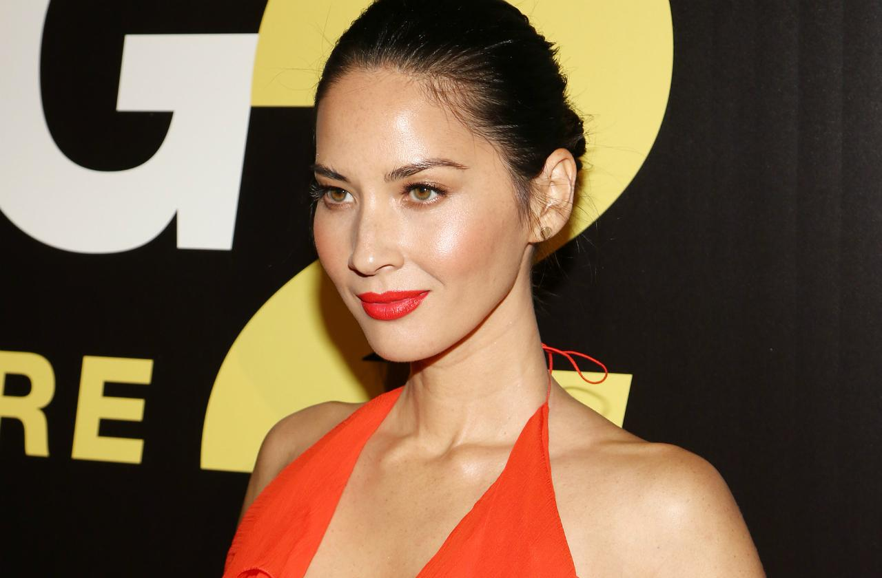 Olivia Munn wore a low cut red ruffled dress, red lips and an updo at the Ride Along 2 premiere.