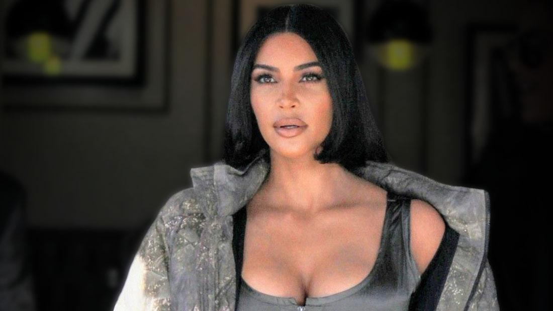 Kim Kardashian Wearing Silver Scoopeneck Vest and Sparkle Puffer Jacket