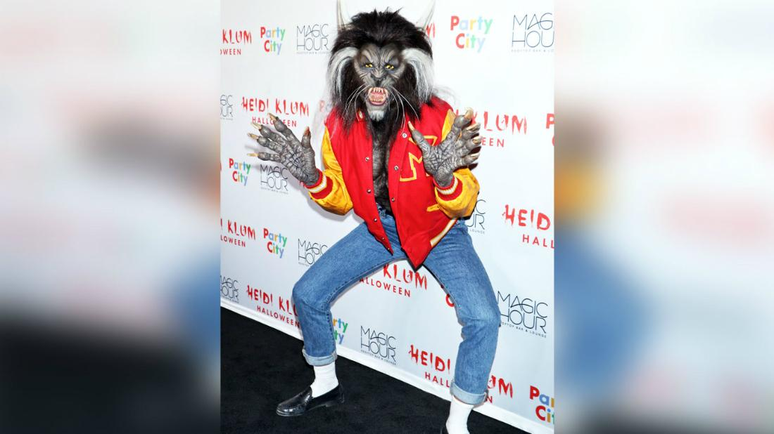 Heidi Klum came as Teen Wolf to her annual Halloween bash, sporting a red varsity jacket, blue jeans and a frightening wolf face.