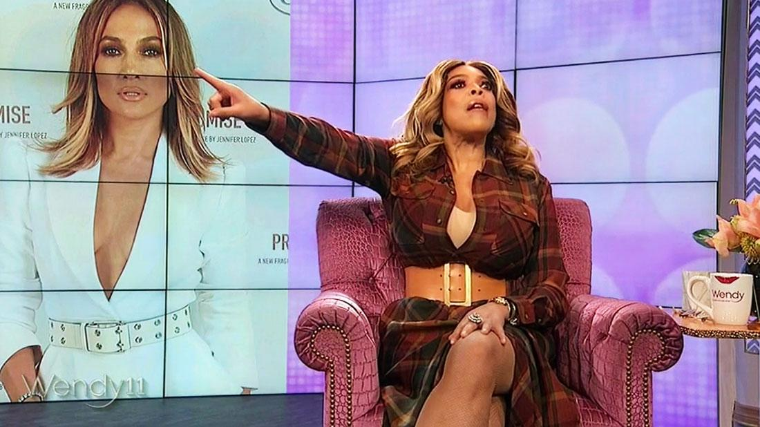 Angry Wendy Williams On Her Show Pointing Right, Wearing Plaid Dress Whlie Telling Audience Member With Cell Phone to Get Out