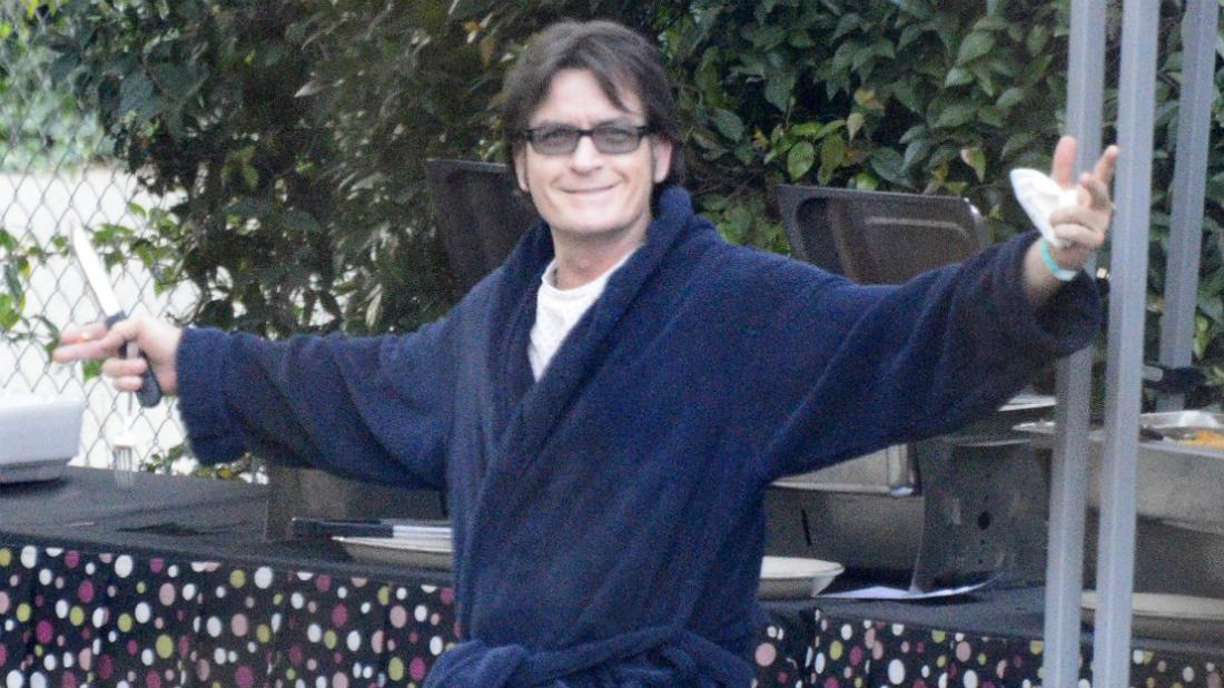 Charlie Sheen wore a blue robe with a white T-shirt underneath as he was seen on the set of the film A Glimpse into the Mind of Charles Swan III.