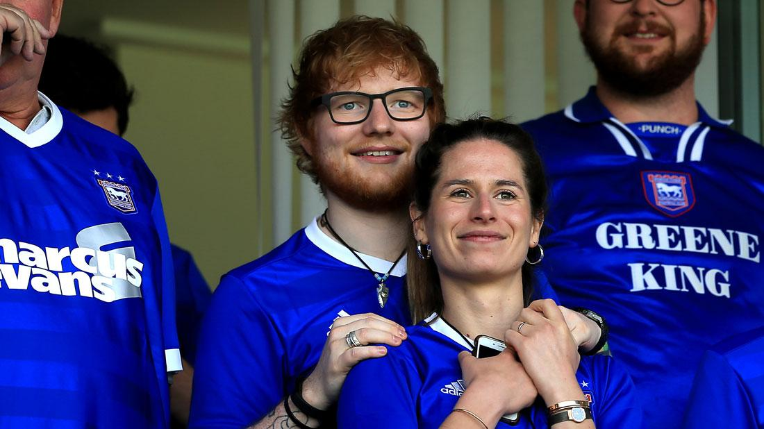 Ed Sheeran and Cherry Seaborn look on during the Sky Bet Championship match between Ipswich Town and Aston Villa at Portman Road.