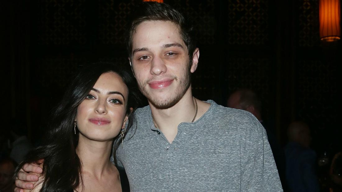 Pete Davidson was all smiles in a grey sweater, alongside girlfriend at the time, Cazzie David, who wore a black dress.