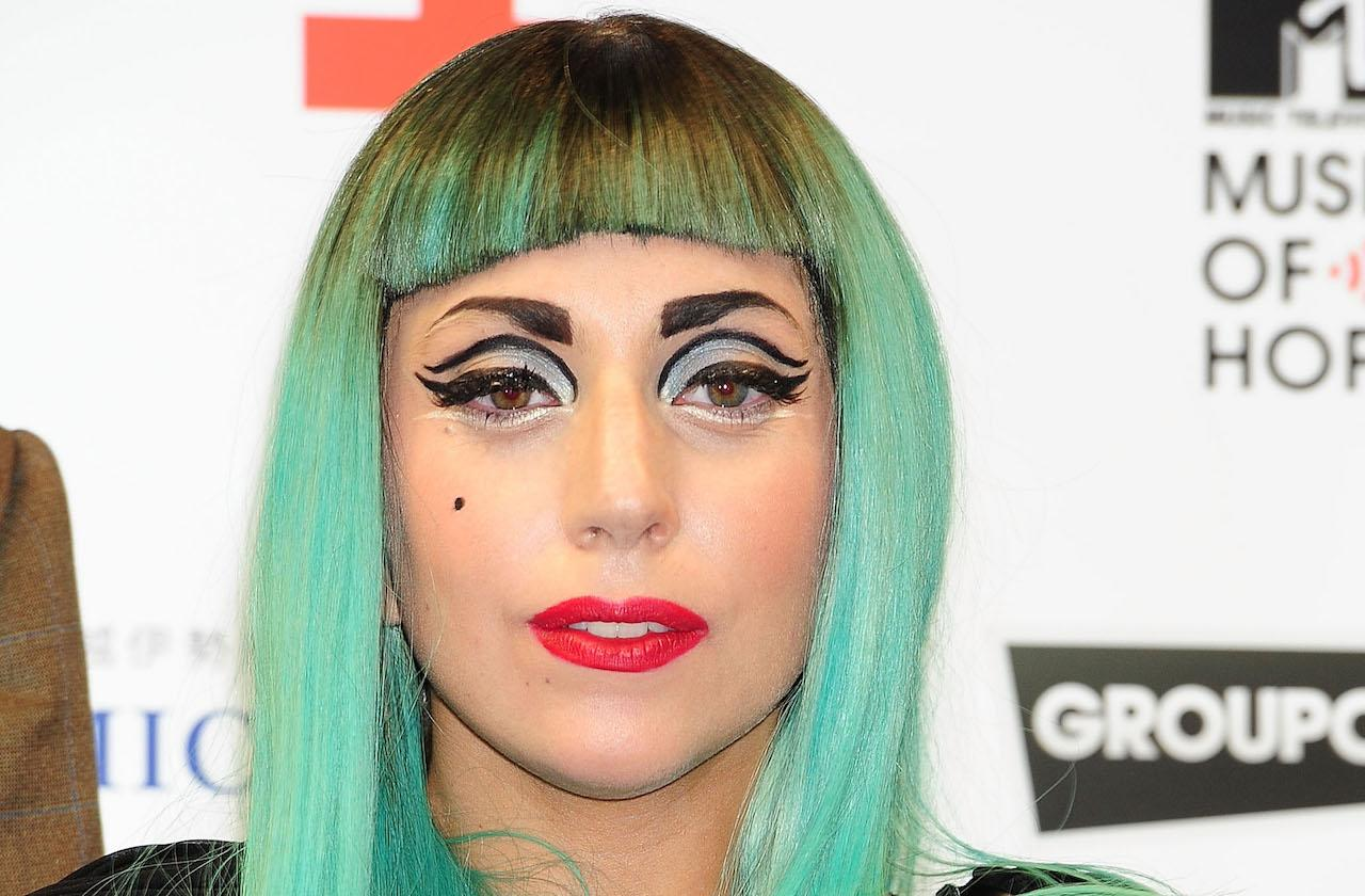 woman with green hair and eyeshadow