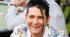 Smiling Corey Feldman Wearing Muticolor Floral Blazer