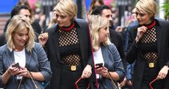 Ashley showed co star Cara Delevingne her phone as they both appeared to laugh as they attended press during the TIFF 2018 festival in Toronto.