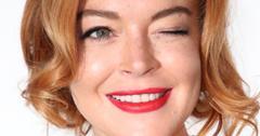 Lindsay Lohan gives the camera a wink in a closeup shot.