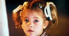 Drew Barrymore marveled at her alien friend in a scene from the classic film, E.T.