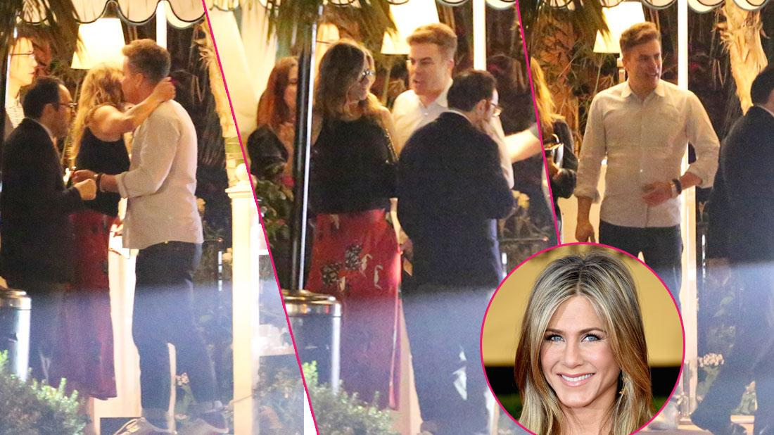 Jennifer Aniston kisses a male friend goodbye after having dinner in Los Angeles. The 50 year old actress is wearing a red skirt with a black top. She dined at the restaurant with a few friends including a mystery man who she gave a hug and a kiss to on the cheek before departing.