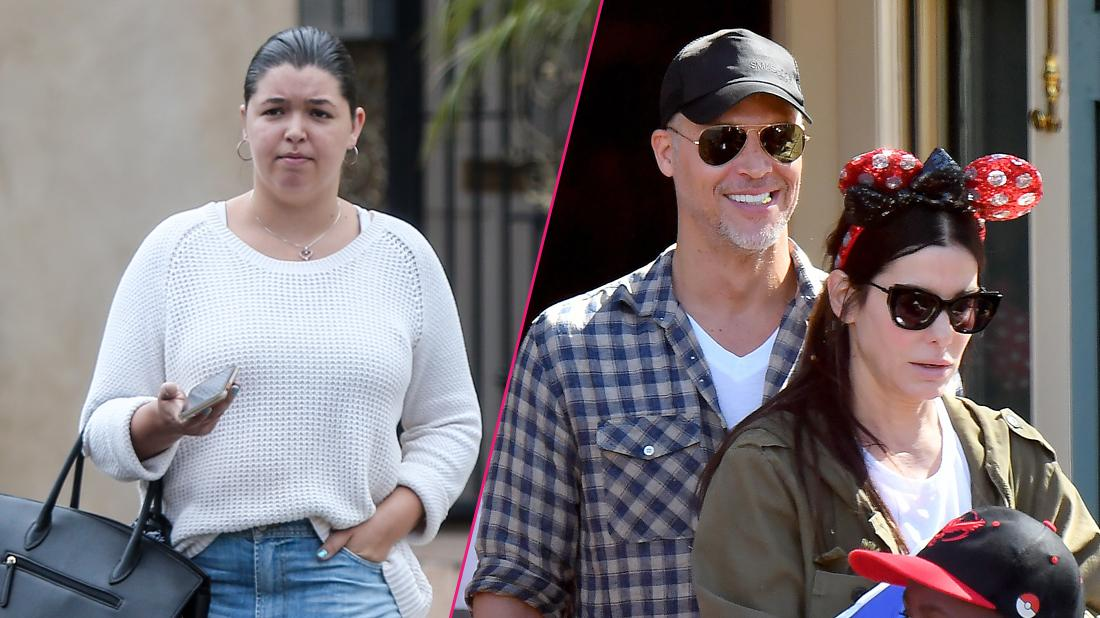 Skylar Staten was later seen heading out for lunch with a friend wearing a slouchy sweatshirt, jeans and colorful sandals while carrying a black oversized handbag. Right, Bryan Randall with Sandra Bullock at Disneyland.
