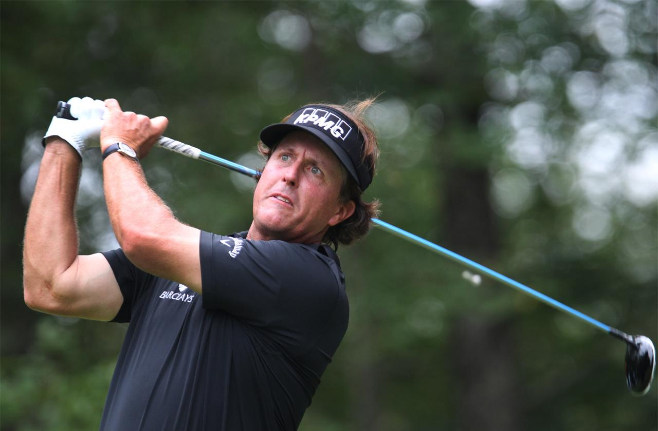//phil mickelson hits moving golf ball with putter pp