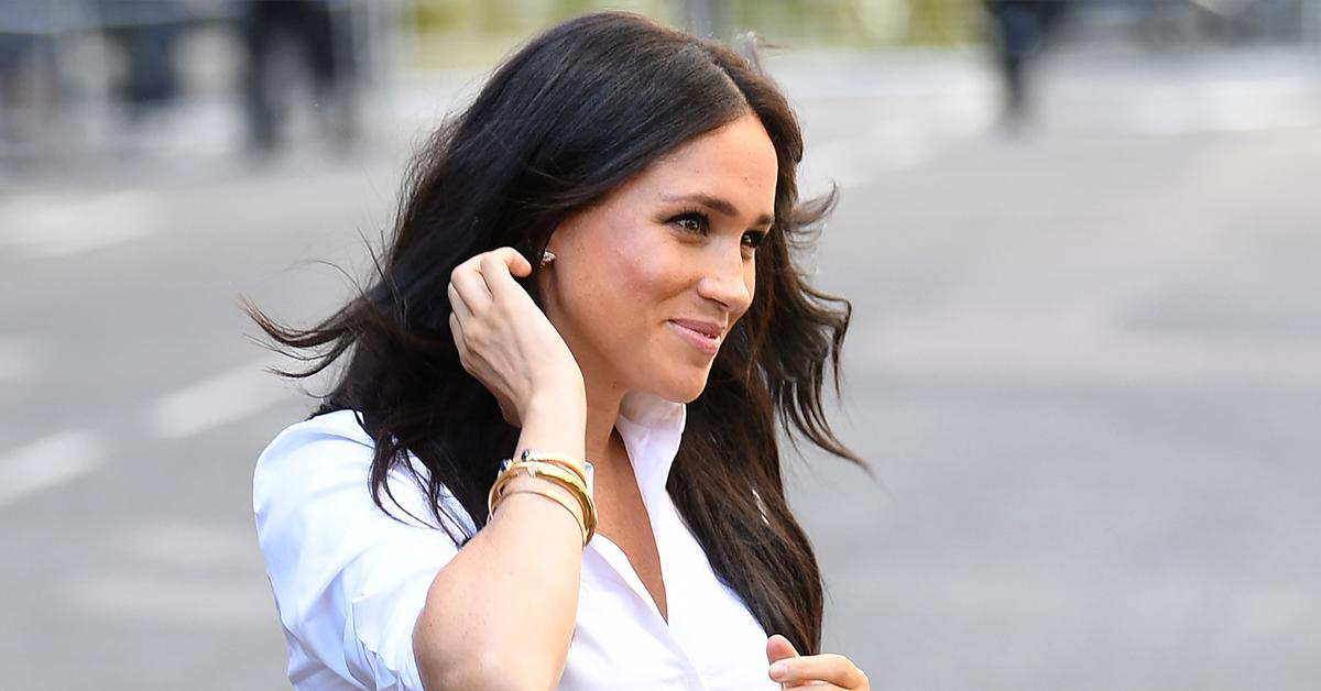 pregnant spotted meghan markle first photos archie ambushed family meeting