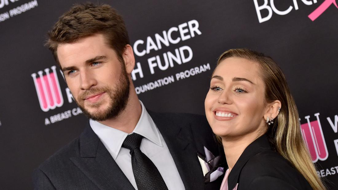 Miley Cyrus and Liam Hemsworth Smiling