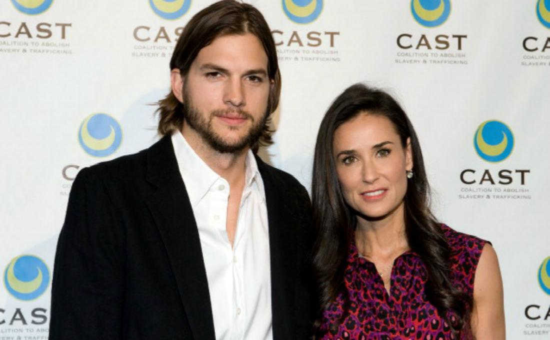 Ashton Kutcher and Demi Moore pose on the red carpet.