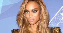 Tyra Banks wears a bronze sequined butterfly sleeve dress, smokey eyes, and long wavy blonde hair at the 2017 America's Got Talent taping.