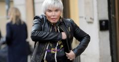 Rodrigo Alves in a black leather jacket, black jeans and patterned black shirt walks down the street.