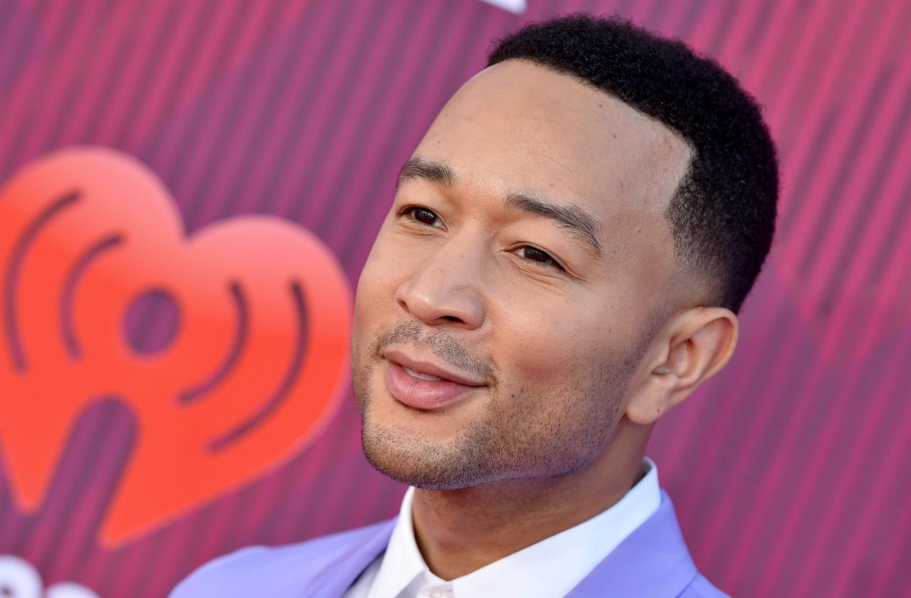 John Legend arrives at the 2019 iHeartRadio Music Awards which broadcasted live on FOX at Microsoft Theater on March 14, 2019 in Los Angeles, California.