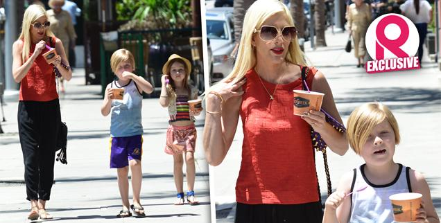 //tori spelling gives candy children behave front cameras wide