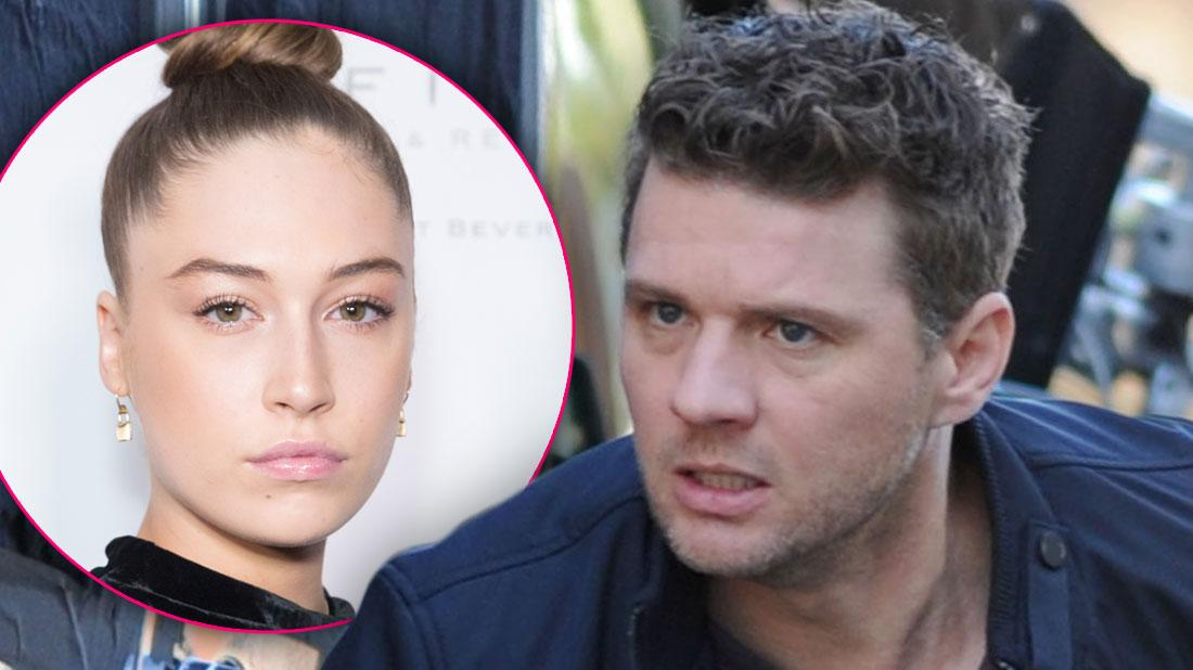 On Left, Inset Photo of Elsie Hewitt with Hair In A Bun, On Right, Ryan Phillippe on Set Looking Angry