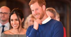 Meghan Markle wears a black and white off the shoulder dress with Prince Harry, dressed in a blue sweater, at Cardiff Castle.