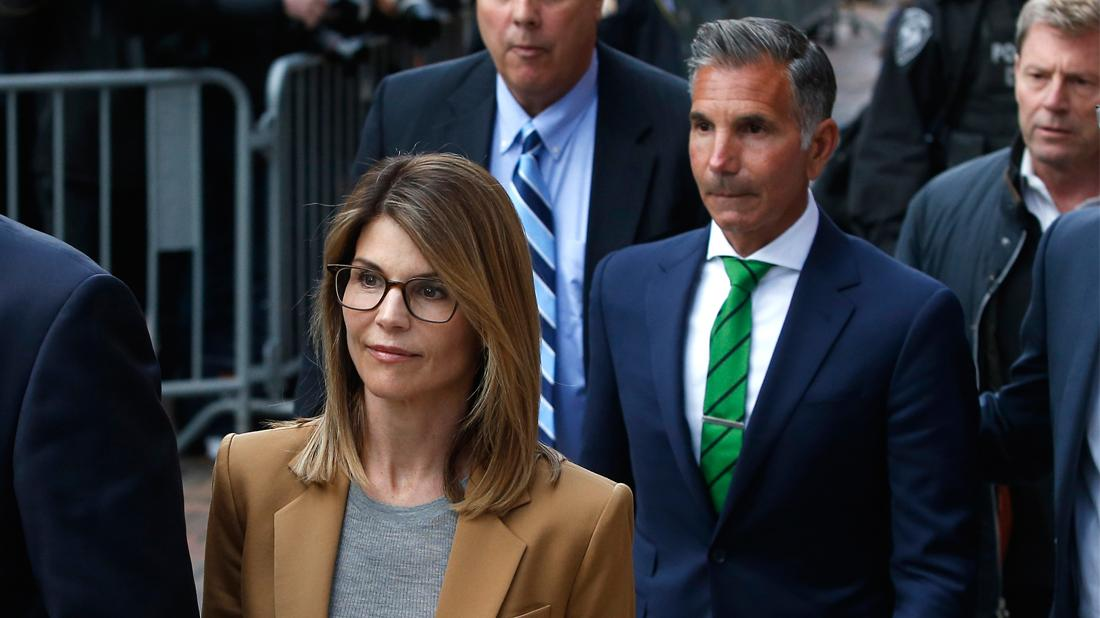 Actress Lori Loughlin, left, leaves as her husband Mossimo Giannulli, right, trails behind her outside of the John Joseph Moakley United States Courthouse in Boston