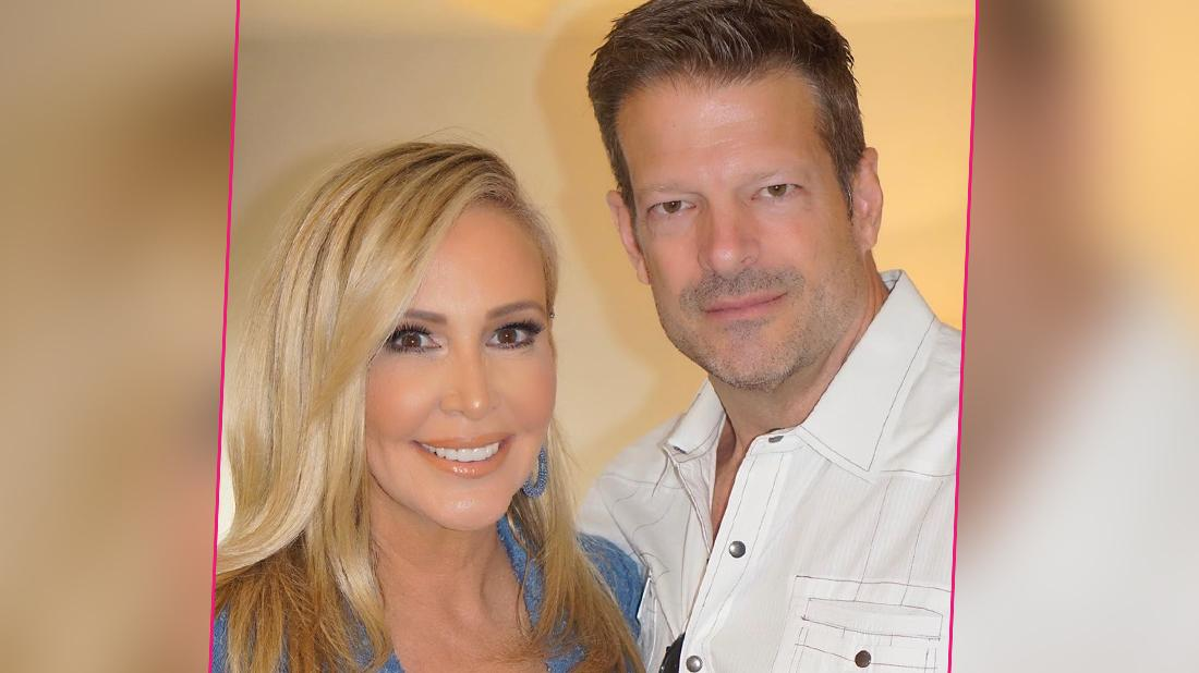 Shannon Beador and John Janssen pose for a photo.
