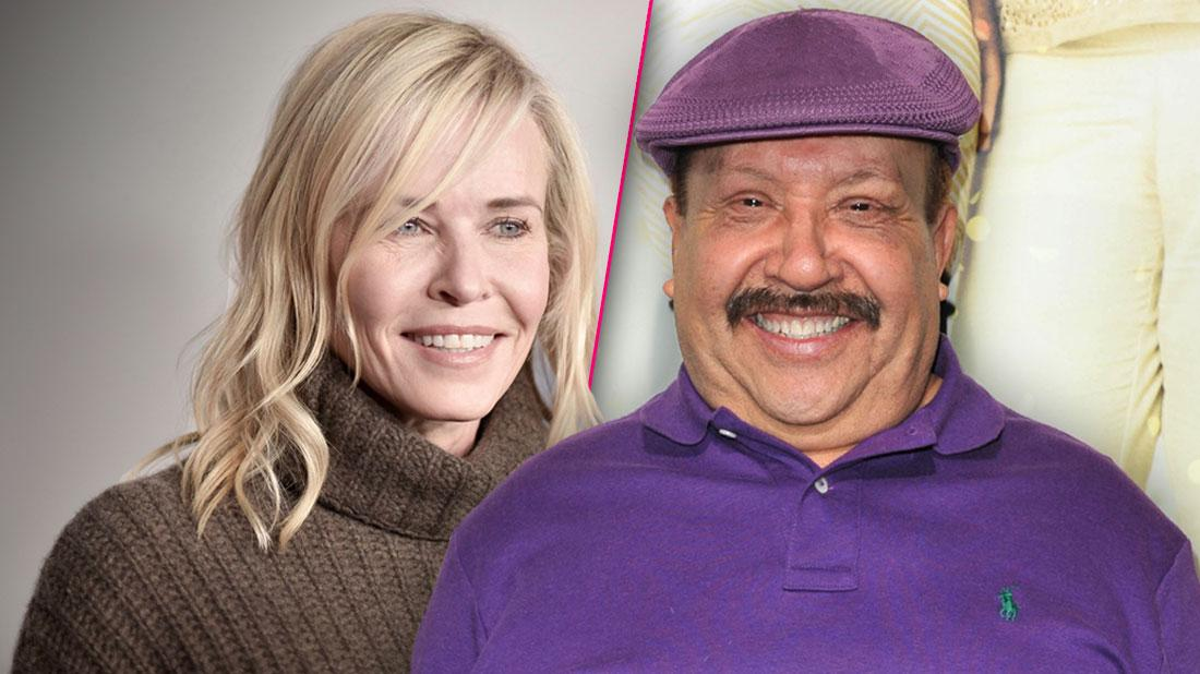 Smiling Chelsea Handler Wearing Brown Turtleneck Sweater, Smiling Chuy Bravo Wearing Matching Purple Golf Cap and Polo Shirt