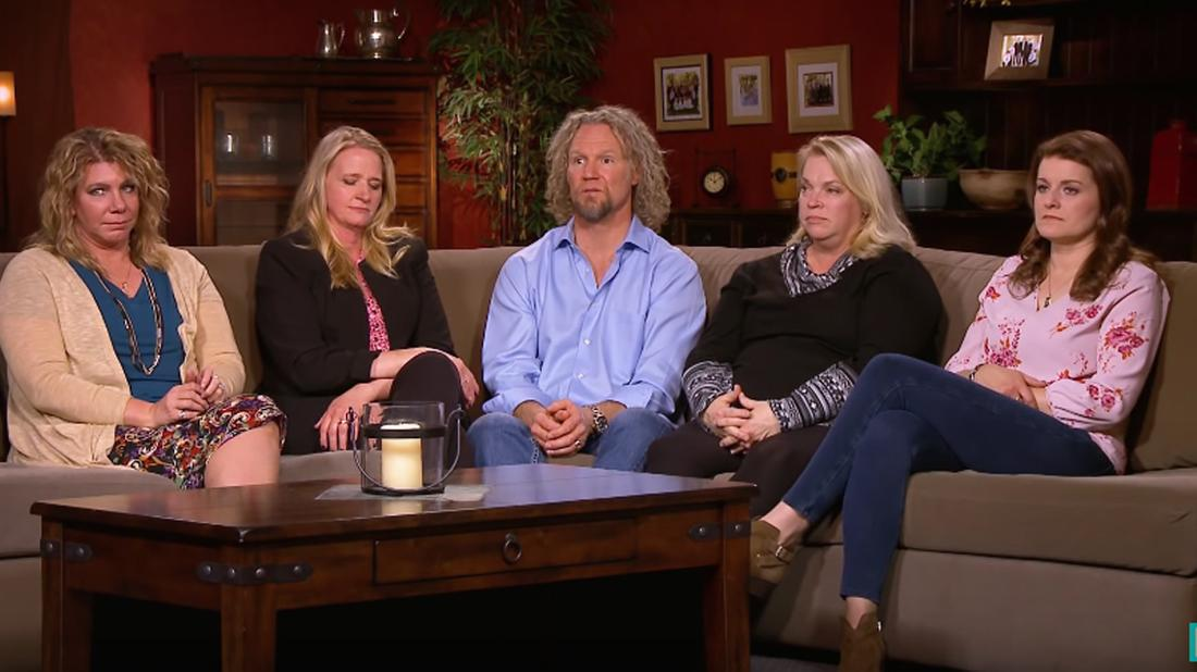Kody Brown wears a blue shirt while seated next jenelle brown who wears a black sweater and a long sleeved shirt.