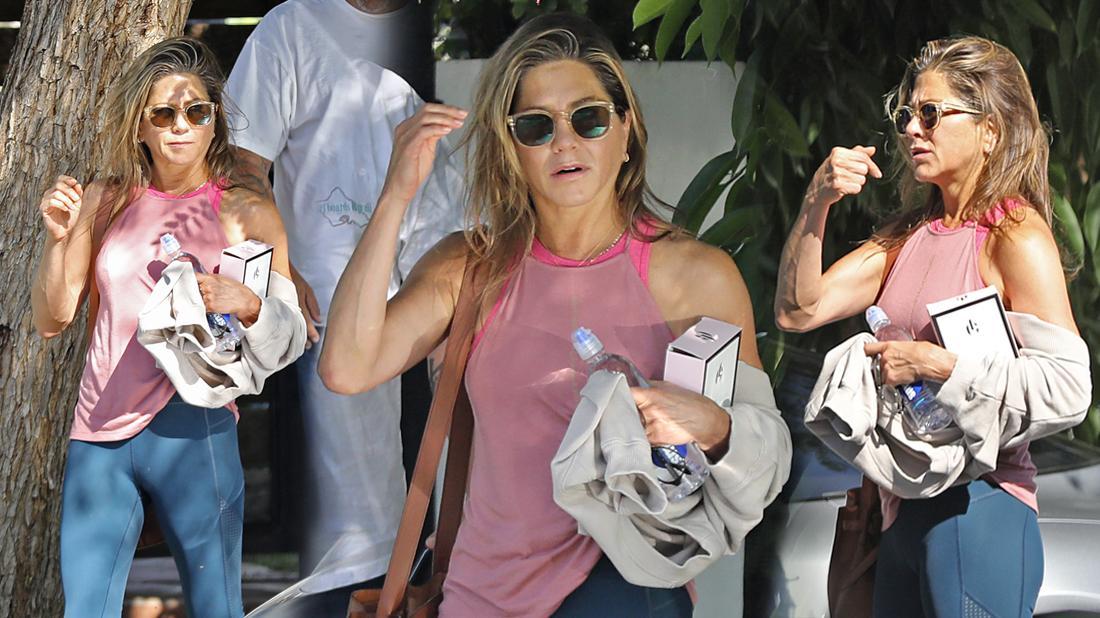 Jennifer Aniston Wearing Sunglasses Pink Tank Top and Navy Leggings Flaunts Body