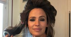 A Selfie of Jennifer Garner with her hair in curlers and eyes squinting